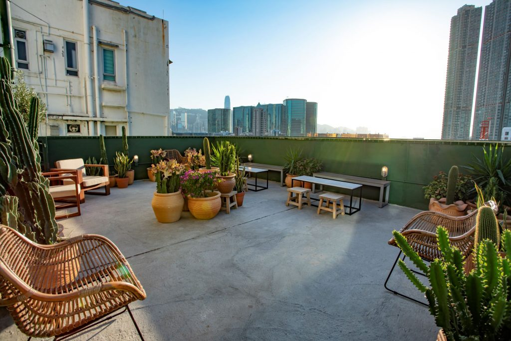 A spacious rooftop welcomes residents wiht tropical