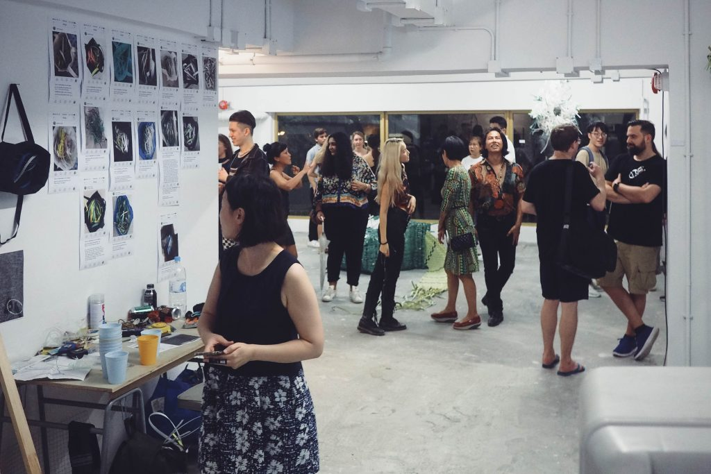 Audiences were having a close look of Go Hung's artwork